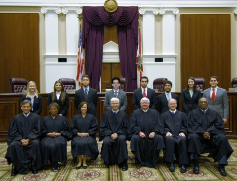 Florida Supreme Court Justices (seated) with 2013 Interns (standing). Chief Justice Ricky Polston (center) and George Arut (center standing)